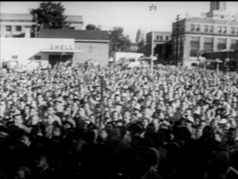 large crowds gather around train adlai stevenson ii at microphone waving to people speaking crowds around dwight 'ike' eisenhower speaking at mic... - united states presidential election stock videos & royalty-free footage