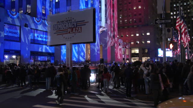 Large crowds gather at Rockefeller Center in NYC to watch the election results come in on big screen televisions