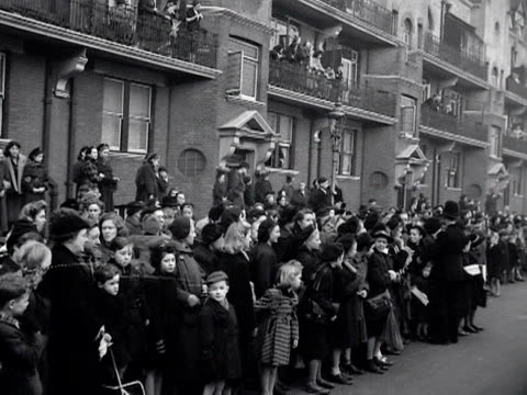 Large crowds gather outside the BBC's Maida Vale studios in preparation for the arrival of Queen Elizabeth and the Duke of Edinburgh 1953