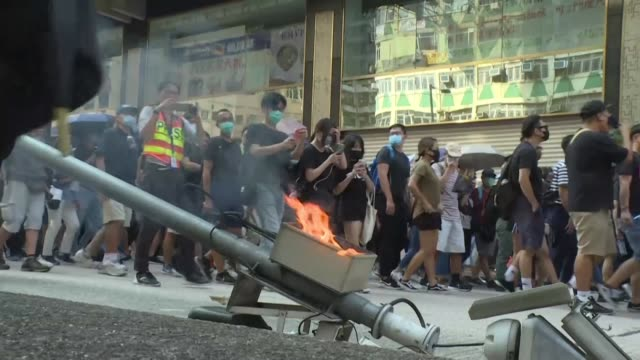 large crowds of hong kongers defy a police ban and hold an illegal march their numbers swollen by anger over the recent stabbing and beating of two... - protestor stock videos & royalty-free footage