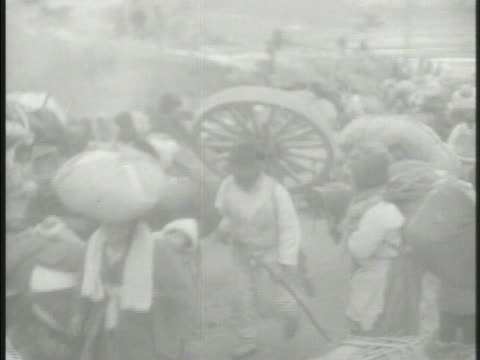 large crowds of north korean refugees w/ luggage large bags carts migrating south on rural roads children being pulled on makeshift bed mat red china... - makeshift stock videos and b-roll footage