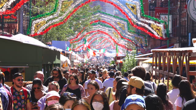 large crowds of people attend the 95th annual feast of san gennaro on mulberry street in little italy on september 19, 2021 in new york city. the... - italian culture stock videos & royalty-free footage