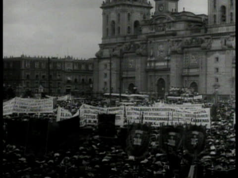 large crowds of workers on strike, protesting, rally. vs paraders w/ spanish signs, banners. crowds standing w/ banners. factory workers - 1935 stock videos & royalty-free footage