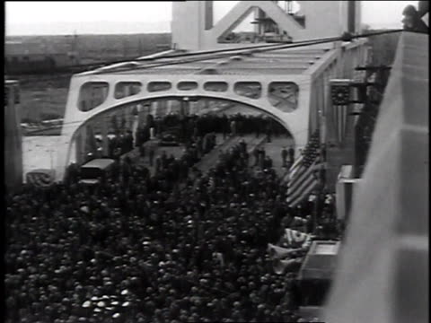 large crowds on bridge / men cutting ribbon / doves flying over large crowds on bridge - 1935 stock videos & royalty-free footage