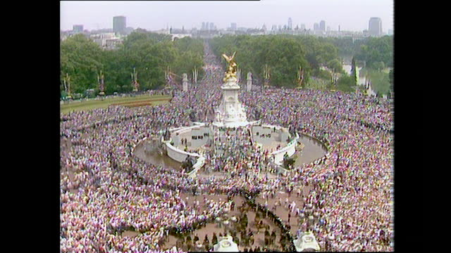 large crowds outside buckingham palace surrounding the victoria memorial on the day of the wedding of prince charles and lady diana spencer; 1981. - english culture stock videos & royalty-free footage