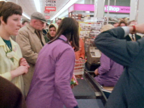 large crowds wait in line at the checkouts of a supermarket. - supermarket stock videos & royalty-free footage