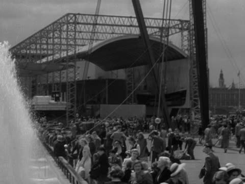 large crowds wander around the festival of britain site on the south bank of the river thames 1951 - festival of britain stock videos & royalty-free footage