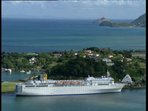 Large cruise liner docked motionless in bay Windward Islands
