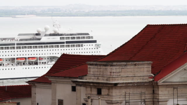 large cruise ship departs harbor in lisbon, portugal. - passagier wasserfahrzeug stock-videos und b-roll-filmmaterial