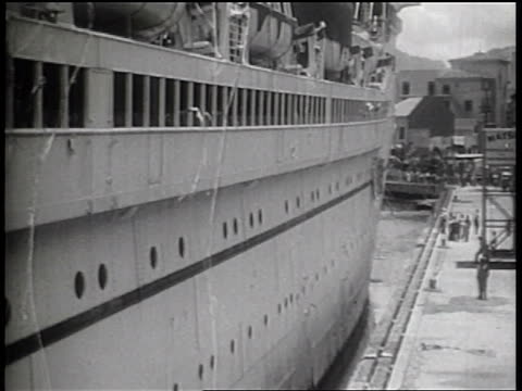 B/W 1936 large cruise ship pulling away from dock