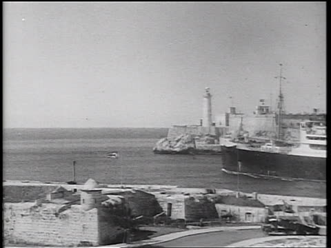 B/W 1934 large cruise ship pulling out of harbor / Havana, Cuba