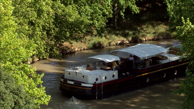 large cruiser on canal du midi - canal du midi stock videos & royalty-free footage