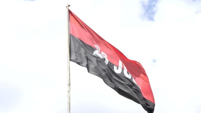 vídeos de stock, filmes e b-roll de large cuban july 26 movement flag flying in the capiro hill or loma del capiro - número 26