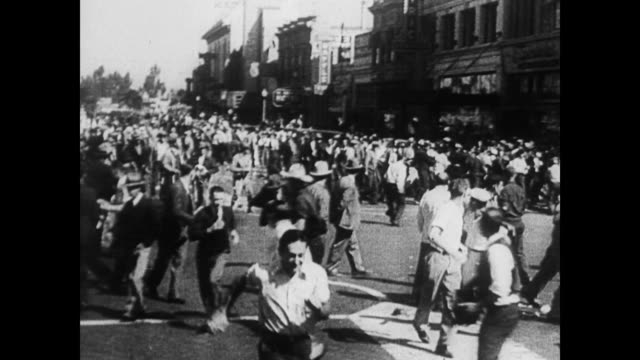 / large demonstration in washington dc / cars moving down overly crowded streets / national guard soldier fires tear gas gun / scenes of shouting,... - 1935 stock videos & royalty-free footage