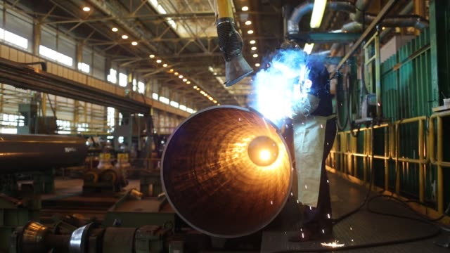 A large diameter steel pipe passes through an automated welding machine at the Izhora Pipe Mill operated by Severstal PJSC in the Kolpino district of...