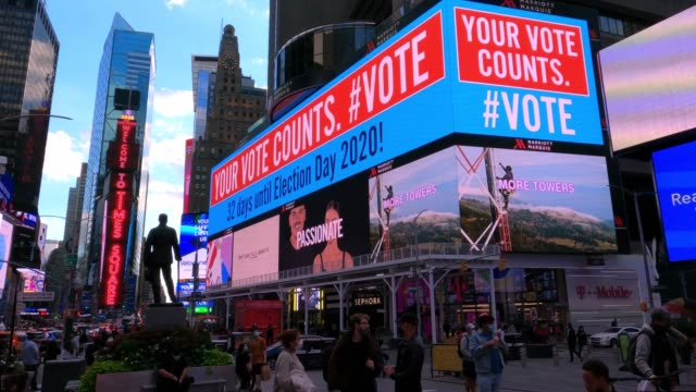 """large digital billboard reads """"your vote counts. #vote"""" in times square on october 02, 2020 in new york city. - kandidat stock-videos und b-roll-filmmaterial"""