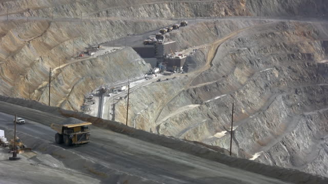 large dump truck hauling iron ore in a mine - copper mine stock videos and b-roll footage