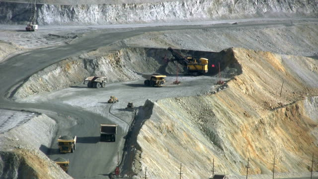large dumptrucks lining up to get copper ore - dump truck stock videos and b-roll footage