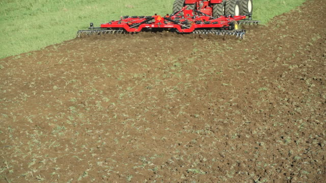 large eight tire tractor plowing farm field - plough stock videos & royalty-free footage