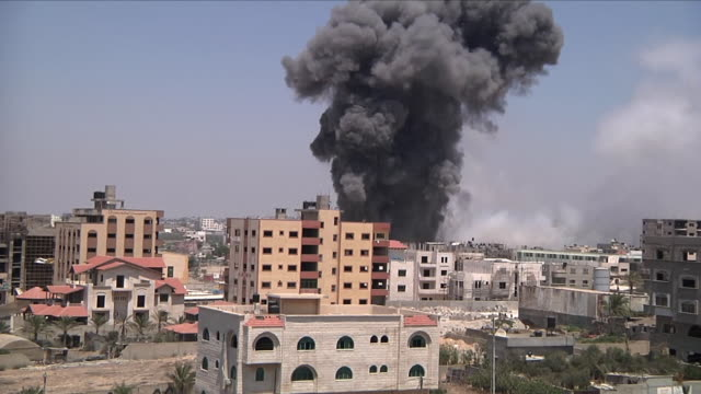 large explosions in middle eastern residential area - air raid stock videos & royalty-free footage