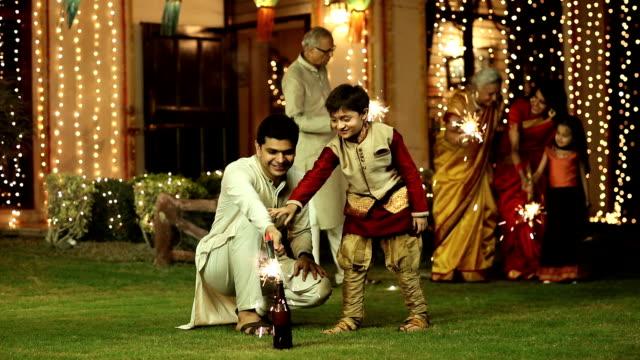 Large family celebrating diwali festival at home, Delhi, India