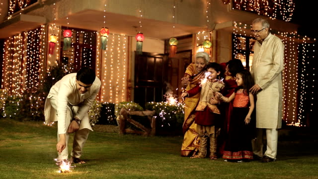 large family celebrating diwali festival at home, delhi, india - celebratory event stock videos & royalty-free footage