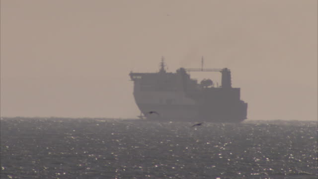 a large ferry heads for open sea after departing from the port of dover. - ferry stock videos & royalty-free footage
