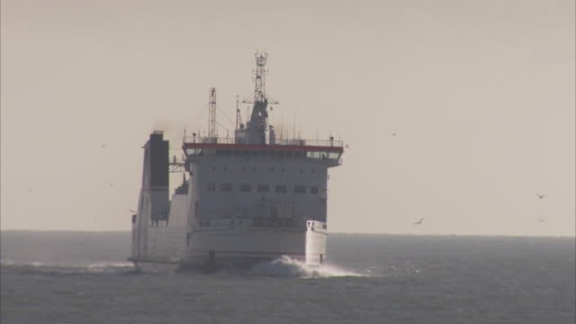 a large ferry moves toward the port of dover from open sea. - ferry stock videos & royalty-free footage