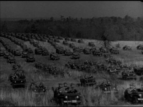 large field of moving military vehicles jeeps armored cars trucks driving across uneven grass field world war ii wwii mobilization mobilizing... - uneven stock videos & royalty-free footage