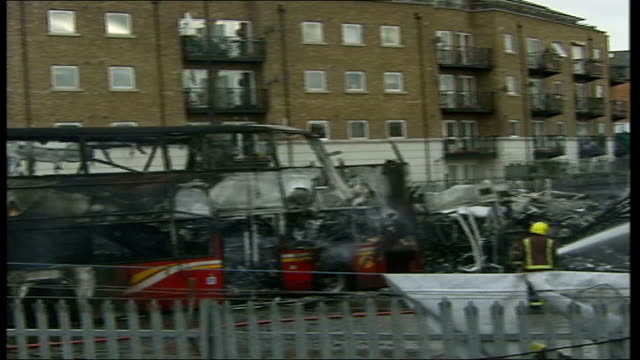 Large fire sweeps through bus depot ENGLAND West London Wreckage of burnt out double decker buses after fire which swept depot Fire Officers with...