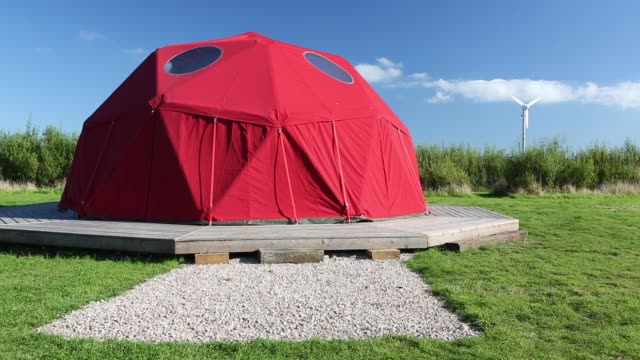 large framed dome tent at mount pleasant ecological park, porthtowan, cornwall, uk. - dome stock videos & royalty-free footage