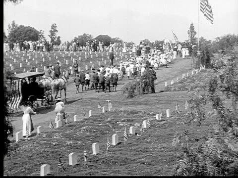 1913 ws b&w large funeral procession moving through cemetary - victorian stock videos & royalty-free footage