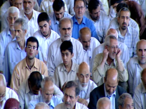 pan large gathering of worshipers seated for midday prayer / qom iran - midday stock videos & royalty-free footage