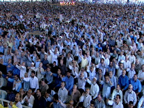 ha large gathering of worshipers seated for midday prayer / qom iran - midday stock videos & royalty-free footage