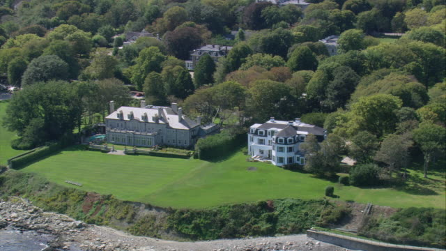 aerial large gilded age mansions near cliff side and promontory into ocean / newport, rhode island, united states - gilded stock videos & royalty-free footage
