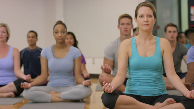 large group meditation in a fitness class - good posture stock videos & royalty-free footage