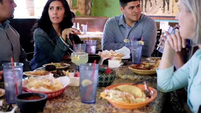 large group of adults having dinner together in mexican food restaurant - margaritas stock videos and b-roll footage