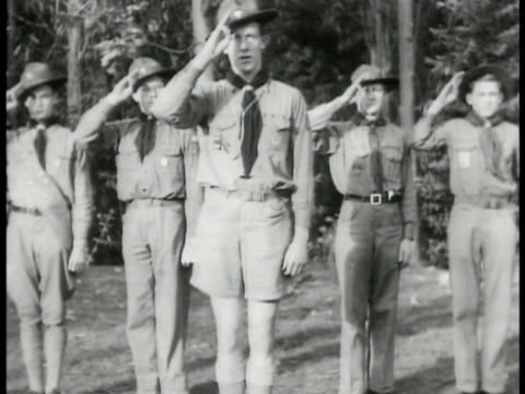 Large group of Boy Scouts standing in formation drum band forest BG VS Scouts standing at attention saluting MS Scout drumming band MS Scout blowing...