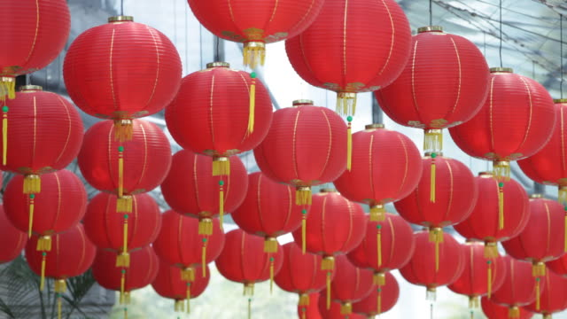 a large group of bright red chinese lanterns sway gently. - swaying stock videos & royalty-free footage