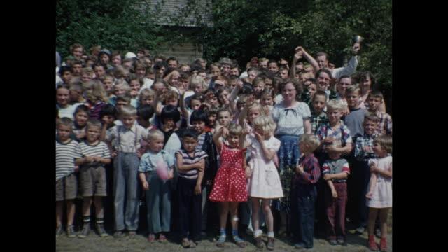 1954 home movie large group of children posing for camera / regina, saskatchewan - saskatchewan stock videos and b-roll footage