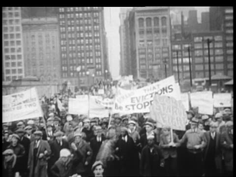 b/w 1932 large group of demonstrators with banners on city street / chicago - 1932 stock videos & royalty-free footage
