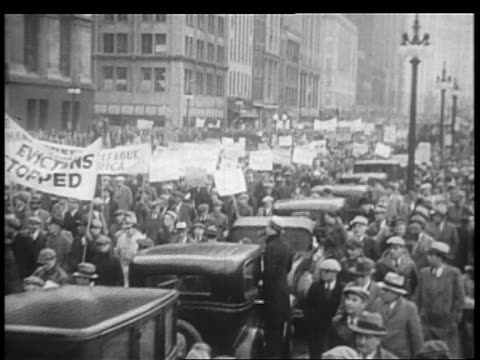 b/w 1932 large group of demonstrators with banners parading on city street sidewalk / chicago - 1932 stock videos & royalty-free footage