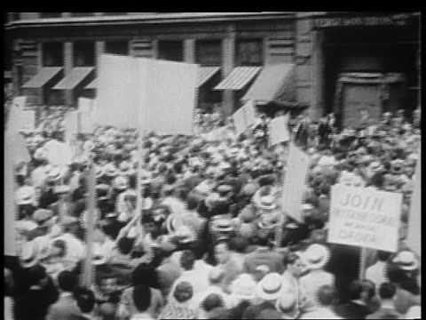 pan large group of demonstrators with signs on city street / chicago - 1932 stock videos & royalty-free footage