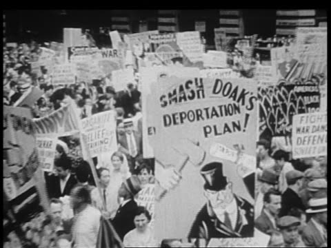 b/w 1932 large group of demonstrators with signs on city street / chicago - 1932 stock videos & royalty-free footage