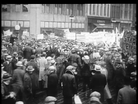 b/w 1932 large group of demonstrators with signs on city streets / chicago - 1932 stock videos & royalty-free footage