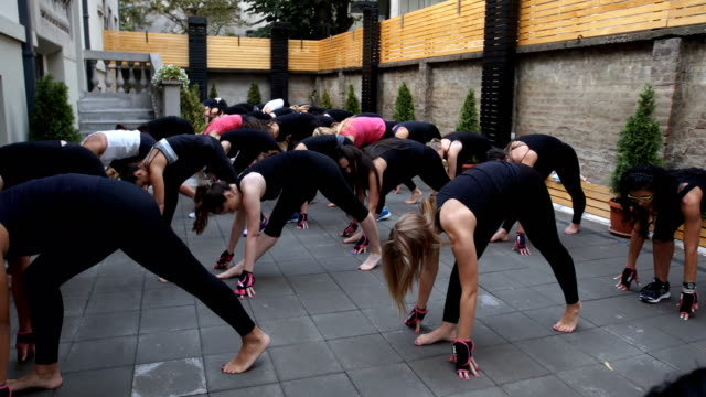 large group of female exercising together - strongwoman stock videos & royalty-free footage