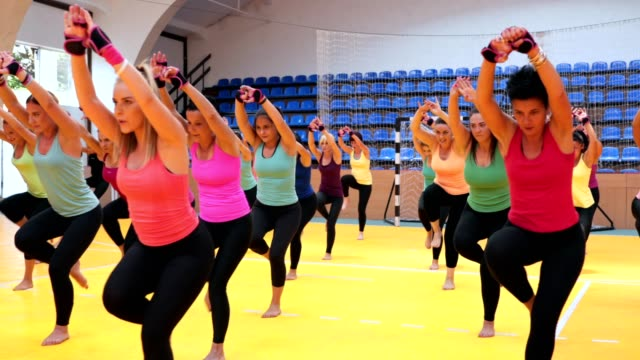large group of fitness women exercising together - aerobics stock videos & royalty-free footage