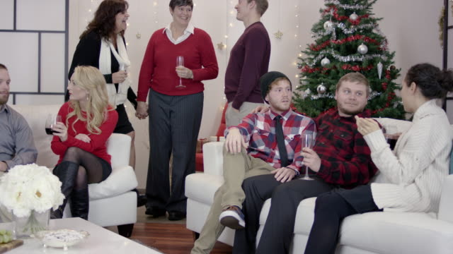 4k uhd: large group of friends at an lgbtq holiday party - intersex stock videos and b-roll footage