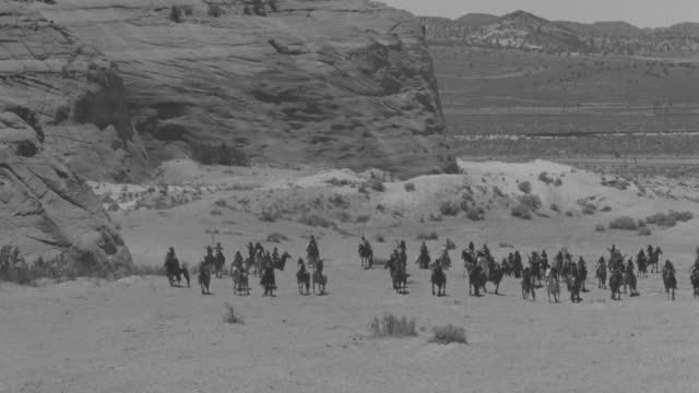 MS PAN Large group of indians riding on landscape