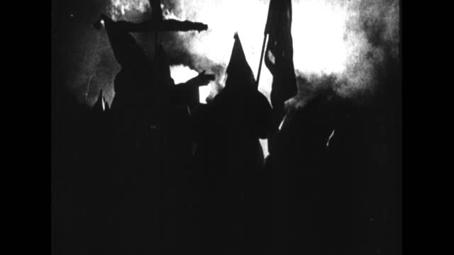 large group of kkk members gather for a rally in a remote area. - kreuz religiöses symbol stock-videos und b-roll-filmmaterial